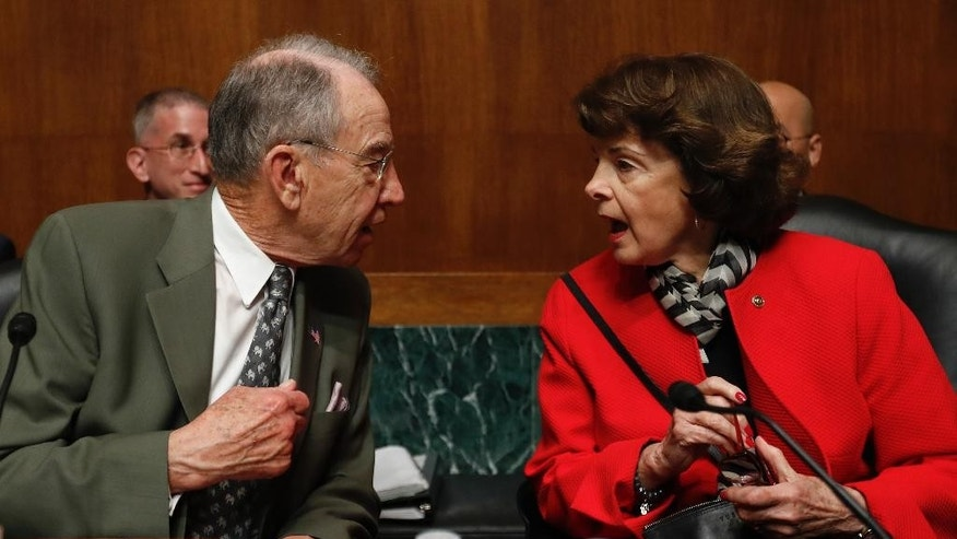 Senate Judiciary Committee Chairman Sen. Charles Grassley, R-Iowa, left, talks with the committee's ranking member Sen. Dianne Feinstein, D-Calif., on Capitol Hill in Washington, Tuesday, May 2, 2017, before the start of the committee's hearing on responses to the increase in religious hate crimes. (AP Photo/Carolyn Kaster)