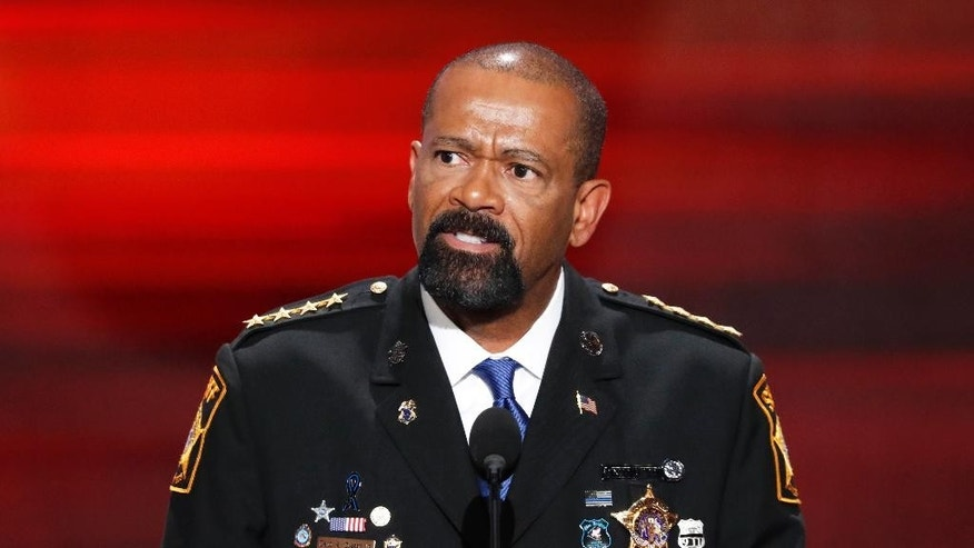 FILE- In this July 18, 2016, file photo, David Clarke, Sheriff of Milwaukee County, Wis., speaks during the opening day of the Republican National Convention in Cleveland. A jury on Monday, May 1, 2017, recommended criminal charges against seven Milwaukee County jail staffers in the dehydration death of an inmate who went without water for seven days. The jail is overseen by Clarke, but the inquest did not target him.  (AP Photo/J. Scott Applewhite, File)