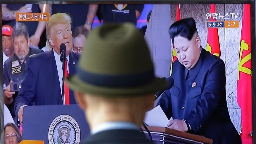 "A TV screen shows images of the U.S. President Donald Trump, left, and North Korean leader Kim Jong Un during a news program at the Seoul Railway Station in Seoul, South Korea, Tuesday, May 2, 2017. South Koreans are bewildered by President Donald Trump's recent use of the term ""smart cookie"" to refer to current leader Kim Jong Un, and by Trump's assertion that he'd be ""honored"" by a possible meeting. (AP Photo/Ahn Young-joon)"