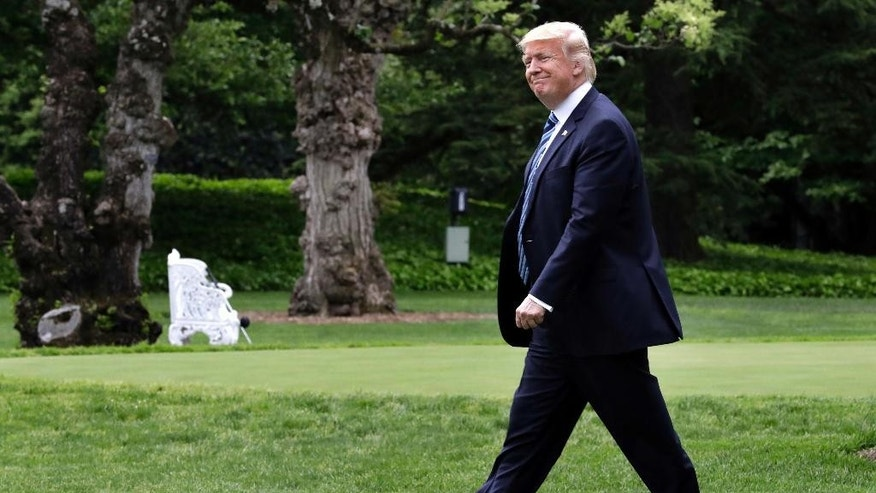 President Donald Trump smiles as he walks to the Marine One helicopter Thursday, May 4, 2017, on the South Lawn of the White House in Washington, en route to New York City. (AP Photo/Jacquelyn Martin)