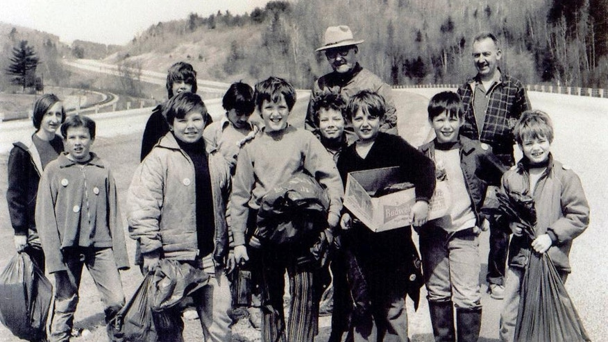 In this April 18, 1970 photo provided by Green Up Vermont, Gov. Deane Davis, wearing hat center rear, poses during the first Vermont Green Up Day with Cub Scouts, including Steve Drebber, wearing striped pants center front, along a Interstate 89 in Middlesex, Vt. This year's statewide Green Up Day will be Saturday, May 6, 2017, when tens of thousands of volunteers will spread out across the state to pick up trash. (Green Up Vermont via AP)