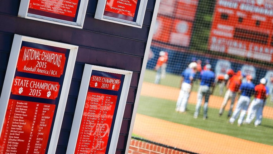 "Plaques mark the accomplishments of the Parkview High School baseball team as they warm up before a baseball game in Lilburn, Ga., on Wednesday, April 26, 2017. Across the U.S., perhaps nowhere is student-on-student sexual assault as dismissed or as camouflaged as in boys' sports, an Associated Press investigation found. Older Parkview players in 2015 were disciplined for sexual battery, in part, after attacking younger teammates, but the district called it ""inappropriate physical contact"" and ""misbehavior."" (AP Photo/John Bazemore)"
