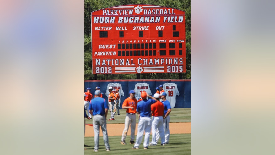 "A scoreboard touts the accomplishments of the Parkview High School baseball team as they warm up before a baseball game in Lilburn, Ga., on Wednesday, April 26, 2017. Across the U.S., perhaps nowhere is student-on-student sexual assault as dismissed or as camouflaged as in boys' sports, an Associated Press investigation found. Older Parkview players in 2015 were disciplined for sexual battery, in part, after attacking younger teammates, but the district called it ""inappropriate physical contact"" and ""misbehavior."" (AP Photo/John Bazemore)"