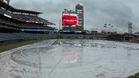 In this photo taken April 25, 2017, the rain tarp covers the infield of Citizens Bank Park in Philadelphia, where the Philadelphia Phillies baseball game against the Florida Marlins was postponed due to bad weather. That whole April showers thing went bit overboard last month in the U.S. The National Oceanic and Atmospheric Administration (NOAA) calculated that April 2017 was the country's second wettest April on record, averaging 3.43 inches for the nation, nearly an inch above the 20th century average. Only 1957 had a slightly wetter April. Records go back to 1895. (AP Photo/Tom Mihalek)