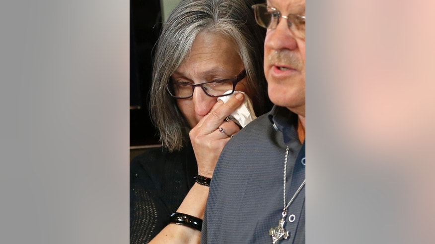 Patty Vasek, left, wipes away a tear as her husband, Ron Vasek talks of the alleged sex abuse coverup he suffered while addressing a news conference Tuesday, May 9, 2017 in St. Paul, Minn. where his attorney, Jeff Anderson announced a lawsuit against Bishop Michael Hoeppner of Crookston, Minn., accusing the bishop and diocese of concealing a report of abuse and threatening retaliation against Vasek if he went public. (AP Photo/Jim Mone)
