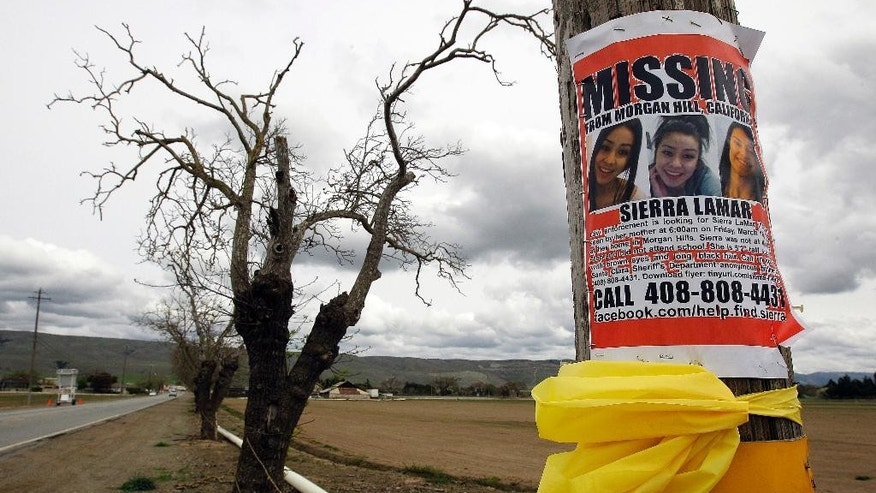 File - In this March 26, 2012, file photo, a missing person poster depicting Sierra LaMar is posted at the intersection of Dougherty and Palm Avenues in Morgan Hill, Calif. This was the intersection where LaMar missed her bus to Sobrato High School. Jurors will deliver their verdict Tuesday, May 9, 2017, in the murder trial Antolin Garcia-Torres accused of randomly abducting and killing LaMar on her way to school, court officials said. (AP Photo/Ben Margot, File)