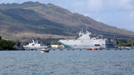 French Navy ships sit in port at Naval Base Guam, Friday, May 12, 2017. Joint Region Marianas Chief of Staff Capt. Jeff Grimes announced Friday that joint exercises involving the U.S., U.K., France and Japan at the U.S. Pacific island of Guam have been indefinitely postponed after a French landing craft ran aground. The exercises, expected to begin Friday, were designed to show support for the free passage of vessels in international waters, an issue that has come to the fore amid concerns China will restrict access to the South China Sea. (AP Photo/Haven Daley)