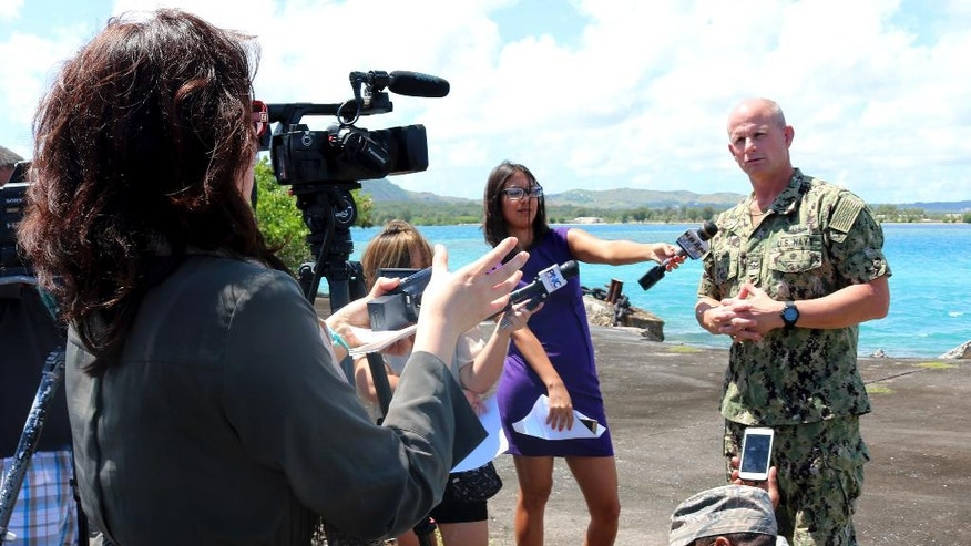 Joint Region Marianas Chief of Staff Capt. Jeff Grimes announces that joint exercises involving the U.S., U.K., France and Japan at the U.S. Pacific island of Guam have been indefinitely postponed after a French landing craft ran aground, Friday, May 12, 2017, on Naval Base Guam. Grimes told reporters he didn't know when the drills would resume. U.S. Naval Base Guam spokesman Jeff Landis says a French catamaran landing craft ran aground just offshore. No one was injured.  (AP Photo/Haven Daley)
