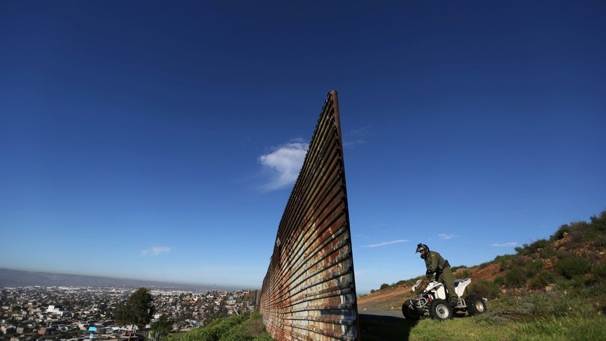 "A member of the U.S. border patrol inspects the area where the border fence separating Mexico and the United States is interrupted, on the outskirts of Tijuana, Mexico, February 21, 2017. REUTERS/Edgard Garrido             SEARCH ""FENCE GARRIDO"" FOR THIS STORY. SEARCH ""WIDER IMAGE"" FOR ALL STORIES. - RTX32K14"