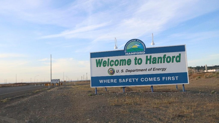 A sign welcomes drivers to Hanford Nuclear Reservation in Benton County Tuesday, May 9, 2017, in Richland, Wash. A portion of an underground tunnel containing rail cars filled with radioactive waste collapsed at a sprawling storage facility in a remote area of Washington state, forcing an evacuation of some workers at the site that made plutonium for nuclear weapons for decades after World War II. (AP Photo/Manuel Valdes)