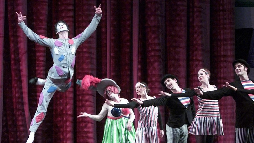 "In this undated photo, Damian Woetzel, as the Harlequin, leaps into the air during Act 1 of Erik Satie's ""Parade"" by the New York Metropolitan Opera in New York Woetzel has been named the new president of the famed Juilliard School Thursday, May 11, 2017, taking over from longtime president Joseph Polisi. After an interim year during which he will learn the ropes alongside Polisi, Woetzel takes the reins in July 2018. (AP Photo/Beth A. Keiser, File)"