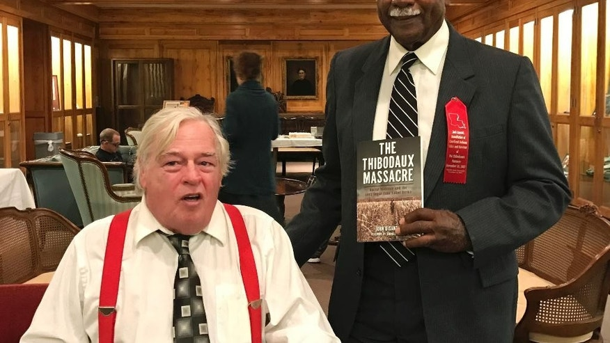 "In this Nov. 13, 2016 photo provided by John DeSantis, author of ""The Thibodaux Massacre: Racial Violence and the 1887 Sugar Cane Labor Strike"" poses with Sylvester Jackson, right, great-grandson of massacre survivor Jack Conrad, at the Nicholls State University archives in Thibodaux, La. Jackson and his family had not known about their relationship to Conrad or the massacre until DeSantis got in touch with them as part of research for the book. (James Loiselle/Courtesy of John DeSantis via AP)"