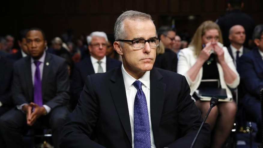 "Acting FBI Director Andrew McCabe sits with a folder marked ""Secret"" in front of him while testifying on Capitol Hill in Washington, Thursday, May 11, 2017, before the Senate Intelligence Committee hearing on major threats facing the U.S. (AP Photo/Jacquelyn Martin)"