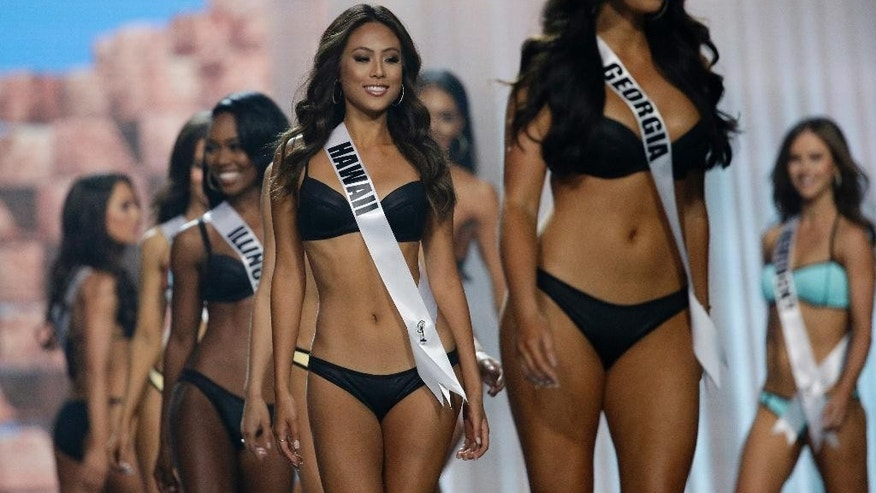 In this May 11, 2017, photo, Miss Hawaii USA Julie Kuo competes during a preliminary competition for Miss USA in Las Vegas. Kuo was born in Tainan, Taiwan, and moved to Hawaii with her family. Five of the contestants vying for the Miss USA title this year were born in other countries and now U.S. citizens. (AP Photo/John Locher)