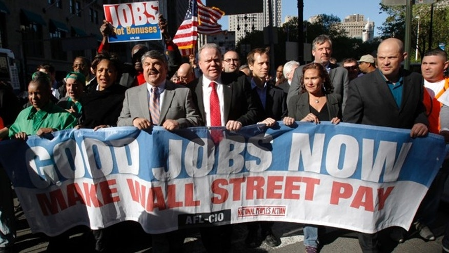 "AFL-CIO President Richard Trumka (3rd L), seen here marching in a 2010 rally, commented in a recent report by his organization ""that the greed of corporate CEOs is driving America's income inequality crisis"""