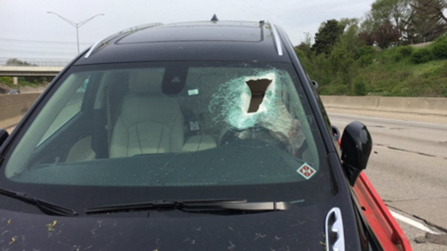 A woman was knocked unconscious Wednesday when a piece of concrete came off I-696 and crashed through her windshield.