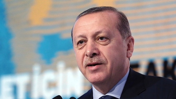 "Turkey's President Recep Tayyip Erdogan addresses a meeting about ""Women and Justice"" in Istanbul, Friday, Nov. 25, 2016. Erdogan on Friday accused the European Union of dishonesty and betrayal, and threatened to remove controls from his country's borders, flooding Europe with hundreds of thousands of asylum-seekers and other migrants. (Murat Cetinmuhurdar/Presidential Press Service, Pool photo via AP)"