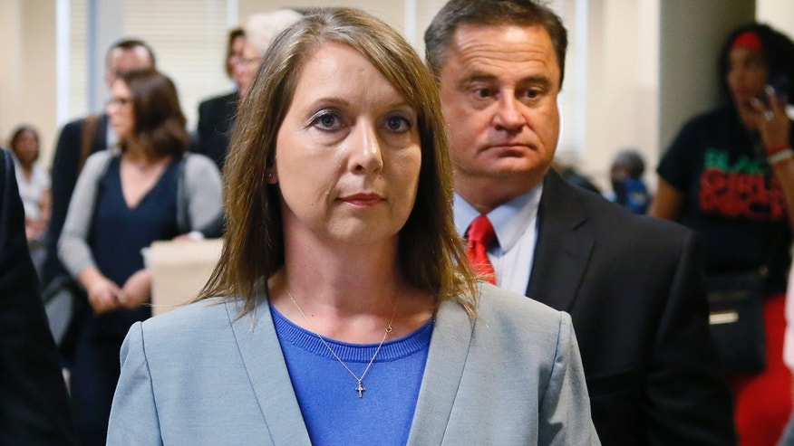 Betty Shelby leaves the courtroom with her husband, Dave Shelby, right, after the jury in her case began deliberations in Tulsa, Okla., Wednesday, May 17, 2017. Shelby is charged with manslaughter in the shooting of Terence Crutcher, an unarmed black man. (AP Photo/Sue Ogrocki)