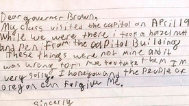 "This photo provided by the Office of Oregon Gov. Kate Brown shows a portion of an apology letter from a fourth-grader to Gov. Brown, explaining that his class had toured the Capitol on a field trip in April 2017 and how he took a hazelnut and a pen from the Capitol Building. In a note replying to the letter, which included the pen in question and a $1 reimbursement for the hazelnut, Brown thanked the young man and wrote ""I accept your apology and forgive you."" (Saerom England/Office of Oregon Governor Kate Brown via AP)"