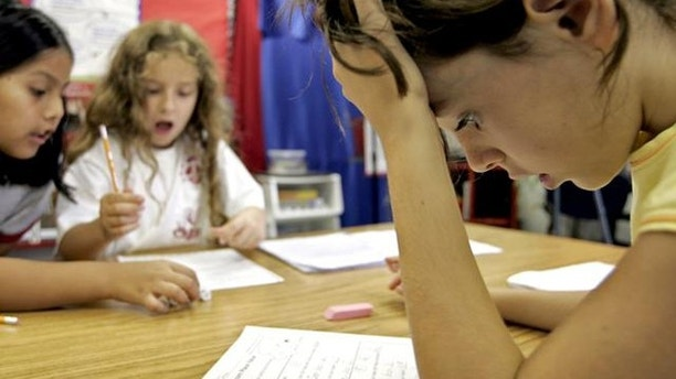 Third grade student Georgia Allin, right, participates in a math exercise with classmates Maria Ortiz-Pozo, left, and Erin Rieman, center, at Barcroft Elementary School in Arlington, Va., Tuesday, Aug. 16, 2005, outside Washington. People in this country have a love-hate relationship with mathematics, a favorite subject for some but just a bad memory for many others, especially women, according to an AP-AOL poll. (AP Photo/Charles Dharapak)