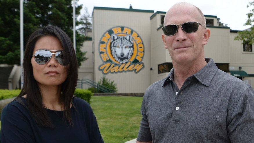 In this Friday, May 26, 2017 photo, parents Denise and Sean Lynch are photographed at San Ramon Valley High School in Danville, Calif.