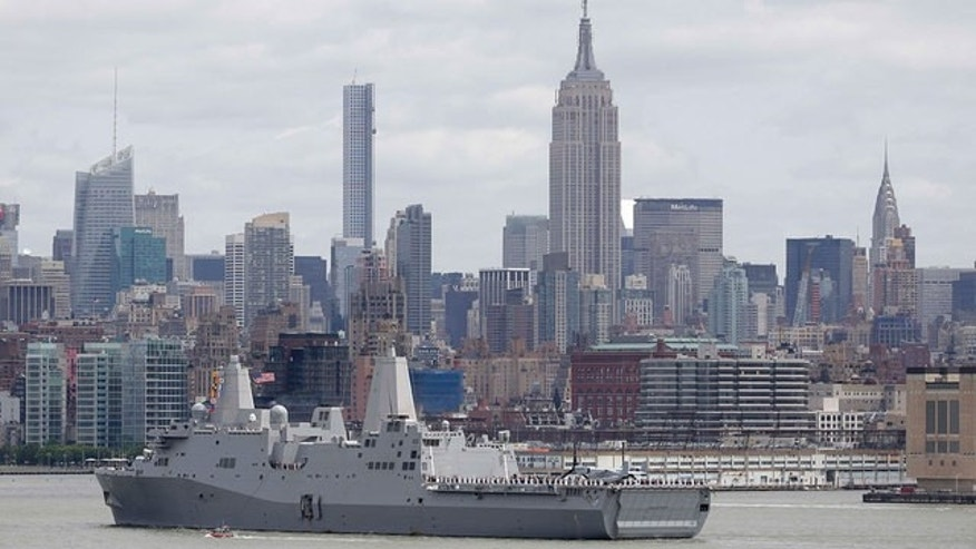 A U.S. Navy ship arrives in New York Harbor to mark the start of Fleet Week.