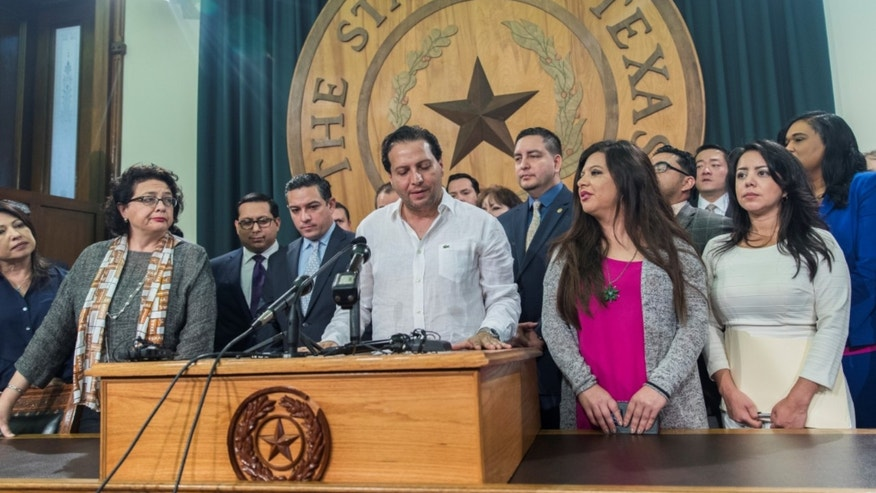 "Texas House Rep. Poncho Nevarez of district 74 speaks about the altercation that he was involved in on the house floor during the last day of session at the state Capitol in Austin Monday, May 29, 2017. A raucous end to a divisive Texas legislative session erupted Monday when a large protest over a ""sanctuary cities"" crackdown provoked a heated scuffle between lawmakers on the House floor. (Ricardo Brazziell/Austin American-Statesman via AP)"