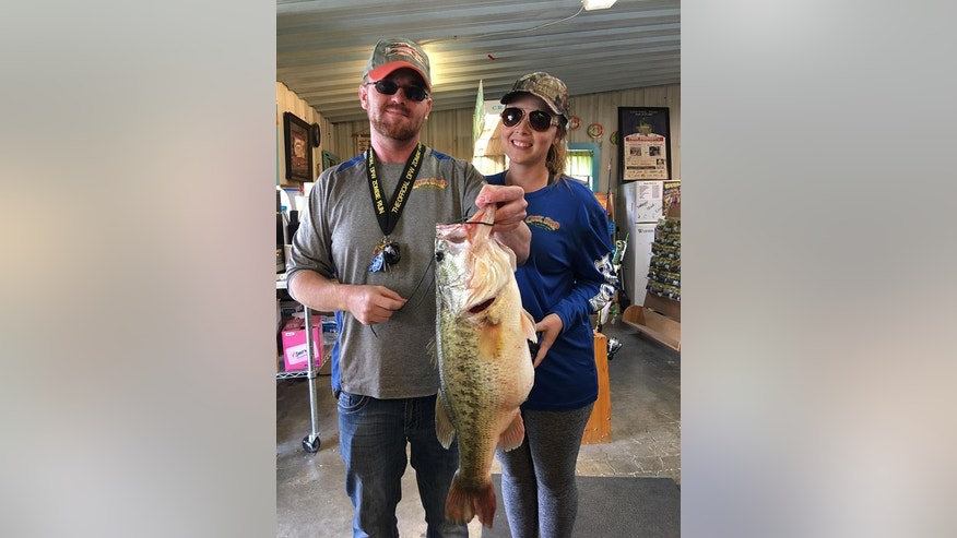 Matthew McNellis and his girlfriend caught the massive bass last month by using a chicken McNugget as bait. (Matthew McNellis)