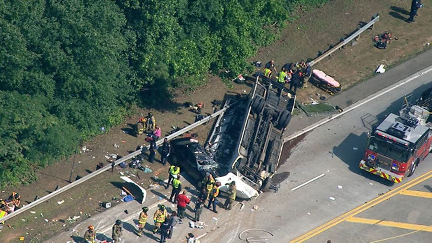 Officials respond to a crash involving a charter bus carrying a church group outside Atlanta.
