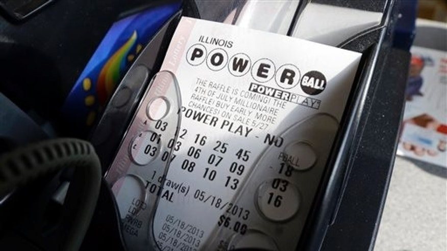 A Powerball lottery ticket is printed out of a lottery machine at a convenience store in Chicago on in this file photo.