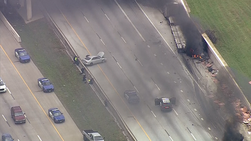 Chase ends in fiery crash, standoff on Arlington interstate