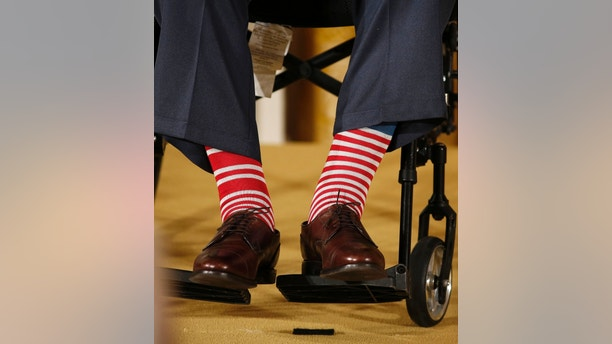 "The socks of former U.S. President George H.W. Bush are seen as he sits in a wheelchair at an event honoring the 5,000th winner of the ""Daily Point of Light"" award in the East Room of the White House in Washington July 15, 2013.      REUTERS/Larry Downing  (UNITED STATES - Tags: POLITICS) - RTX11NMC"