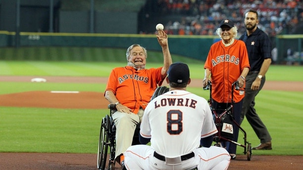 Oct 11, 2015; Houston, TX, USA; Former president George H. W. Bush throws out the ceremonial first pitch to Houston Astros third baseman Jed Lowrie (8) prior to game three of the ALDS against the Kansas City Royalsat Minute Maid Park. Mandatory Credit: Troy Taormina-USA TODAY Sports - RTS40LL