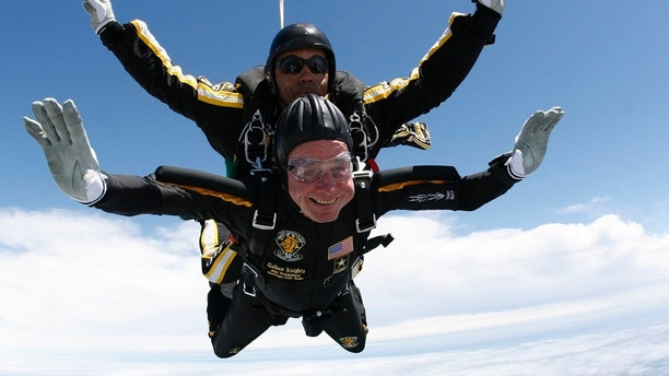 Former U.S. President George H.W. Bush (bottom) celebrates his 85th birthday by jumping with the Army's Golden Knight parachute team in a tandem jump with SFC Michael Elliott in Kennebunkport, Maine in this handout photograph released June 12, 2009. REUTERS/U.S. Army Parachute Team/Handout /Files  (UNITED STATES - Tags: SOCIETY PROFILE) FOR EDITORIAL USE ONLY. NOT FOR SALE FOR MARKETING OR ADVERTISING CAMPAIGNS - RTR3B2OG