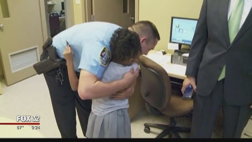 Seven-year-old Rosalyn Baldwin hugs a Chicago police officer