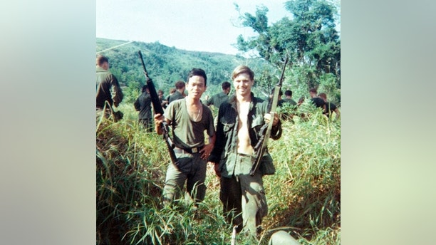 This 1969 photo provided by James McCloughan shows him with the former Army medic, right, with a platoon interpreter in Nui Yon Hill in Vietnam. An Army spokeswoman said Tuesday, June 13, 2017, that McCloughan, who saved the lives of 10 soldiers during the Battle of Nui Yon Hill in May 1969 in Vietnam, will become the first person to be awarded the nation's highest military honor by President Donald Trump. (Courtesy of James McCloughan via AP)