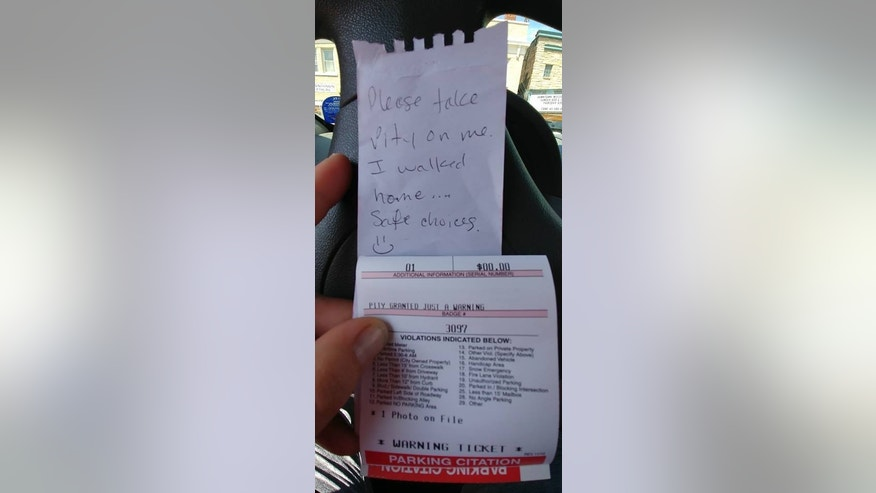 "A Wisconsin officer issued a ""pity"" warning to a driver after finding a funny note left on the individual's car parked in an overdue meter spot. (Wausau Police Department)"