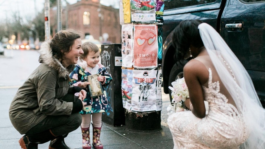 Bride takes photos with girl who thought she was princess