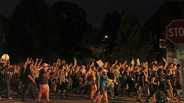Supporters of Philando Castile hold signs as they march along an on-ramp for Interstate 94 in St. Paul, Minn., after leaving a vigil at the state Capitol on Friday, June 16, 2017.  A Minnesota police officer was cleared Friday in the fatal shooting of Castile, a black motorist whose death captured national attention when his girlfriend streamed the grim aftermath on Facebook. (Anthony Souffle/Star Tribune via AP)
