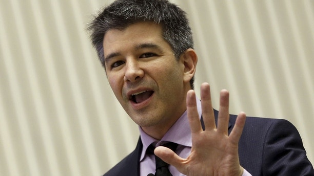 Uber CEO Travis Kalanick gestures as he addresses a gathering during a conference of start-up businesses in New Delhi, India, January 16, 2016. REUTERS/Adnan Abidi - RTX22ONF