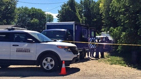 Authorities investigate a scene in Caldwell, Idaho, on Monday, June 19, 2017. Police say three people were found dead inside a home and the Canyon County Sheriff's office is investigating the deaths as possible homicides. (AP Photo/Kimberlee Kruesi)