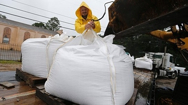 Volunteers put out sand bags due to the arrival of Tropical Storm Cindy in Lafitte, La., Wednesday, June 21, 2017. Tropical Storm Cindy sent drenching rain bands over the north Gulf Coast on Wednesday, swamping low-lying coastal roads and pushing a waterspout ashore in one beachfront community as residents from east Texas to the Florida Panhandle warily eyed the storm's slow crawl toward land. (AP Photo/Gerald Herbert2