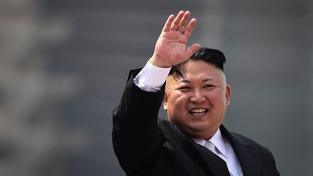 FILE - In this Saturday, April 15, 2017, file photo, North Korean leader Kim Jong Un waves during a military parade in Pyongyang, North Korea, to celebrate the 105th birth anniversary of Kim Il Sung, the country's late founder and grandfather of current ruler Kim Jong Un. North Korea has accused the U.S. and South Korean spy agencies of an unsuccessful assassination attempt on leader Kim Jong Un involving bio-chemical weapons. (AP Photo/Wong Maye-E, File)