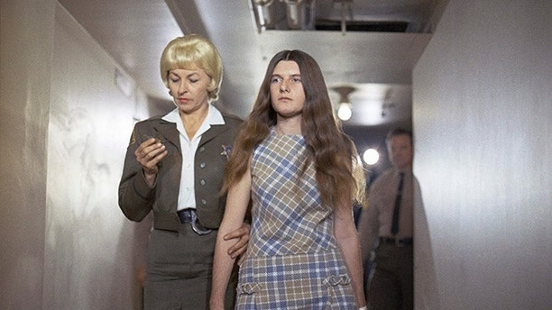 FILE - In this Feb. 24, 1970 file photo, Patricia Krenwinkel, a defendant in the Tate murder case, enters the superior court in Los Angeles for an arraignment. Parole has again been denied for convicted killer Krenwinkel. The parole board did not immediately release the reason for its recommendation Thursday, June 22, 2017, at the California Institution for Women east of Los Angeles. The 69-year-old Krenwinkel was previously denied parole 13 times for the 1969 slayings of pregnant actress Sharon Tate and four other people. (AP Photo/George Brich, File)
