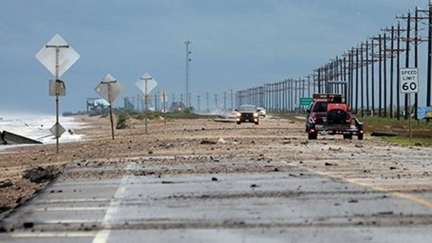 Debris covers TX-87 as a result of Tropical Storm Cindy on Thursday, June 22, 2017, in Bolivar Peninsula, Texas. (Elizabeth Conley/Houston Chronicle via AP)