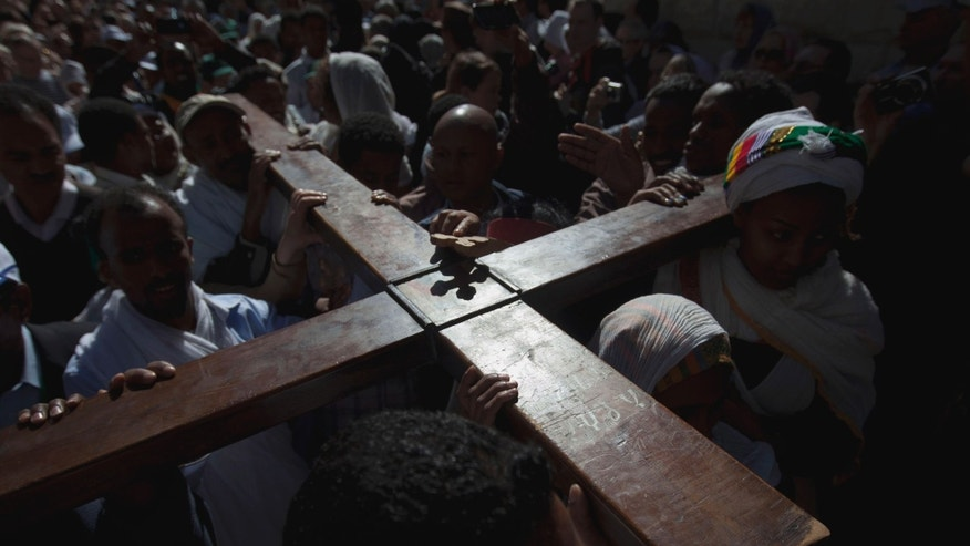 Orthodox Christian worshippers carrying a cross on Good Friday in Jerusalem, in 2012.