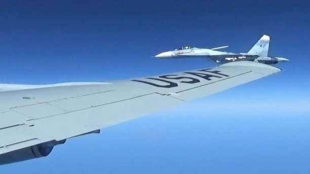 This is a  dramatic photo of a Russian jet coming within a few feet of a U.S. Air Force reconnaissance jet over the Baltic Sea June 19, 2017, in a maneuver that has been criticized as unsafe. The photographs released Friday june 23, 2017  show the Russian SU-27 coming so close to the wing of the U.S. RC-135U the Russian pilot can be seen sitting in the cockpit in some images. ( Master Sgt Charles Larkin Snr/U.S. European Command via AP)