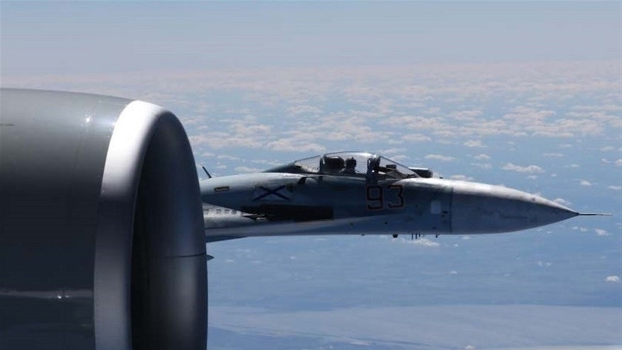 The U.S. European Command has released photos of a Russian jet flying within a few feet of a U.S. Air Force reconnaissance jet over the Baltic Sea on June 19, 2017.