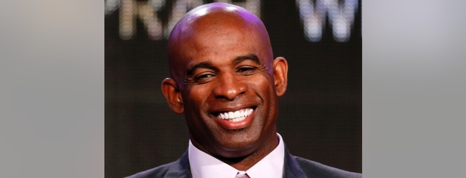 "Deion Sanders talks about OWN: Oprah Winfrey Network's ""Deion's Family Playbook"" during the Winter 2014 TCA presentations in Pasadena, California, January 9, 2014. REUTERS/Lucy Nicholson (UNITED STATES - Tags: ENTERTAINMENT PROFILE HEADSHOT SPORT FOOTBALL) - RTX177SQ"