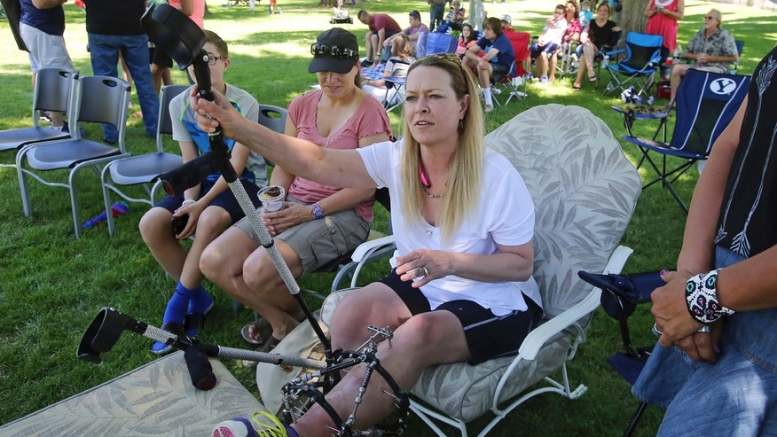 Melissa Cochran, who was injured in the March 22 London terror attack, and whose husband Kurt Cohran was killed, attends a memorial concert Saturday, June 24, 2017, in Bountiful, Utah.